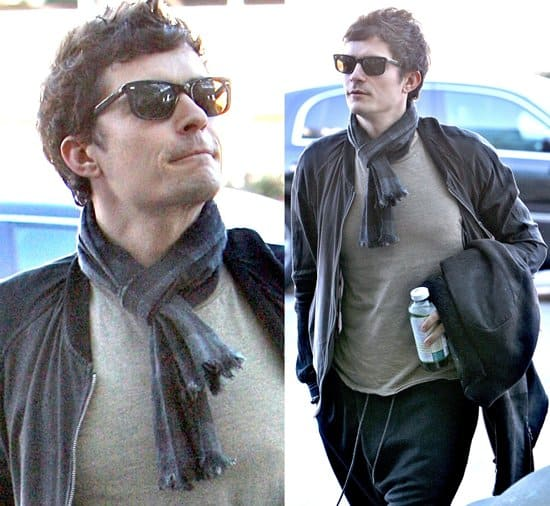 Orlando Bloom arrives at LAX airport wearing 'MC Hammer' style trousers and sunglasses to board a flight to London. He was also drinking from a bottle of Kombucha, a health drink, on November 25, 2009