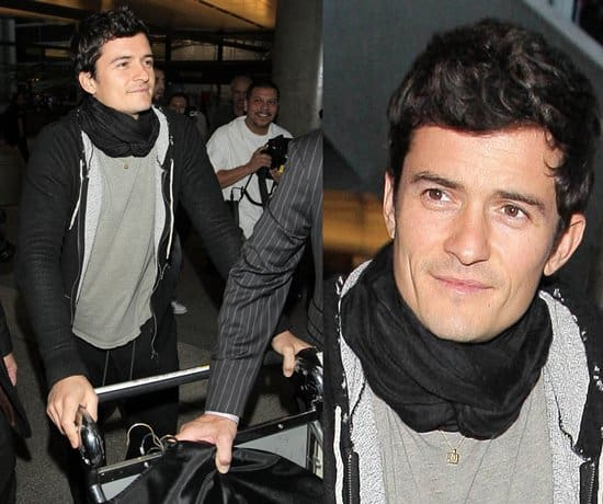 Orlando Bloom pushing a luggage trolley at LAX airport, arriving on a flight from London, on November 30, 2009