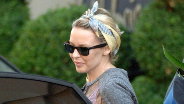 Kylie Minogue wears a chic headscarf
