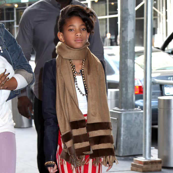 Willow Smith wearing a cozy camel scarf around her neck
