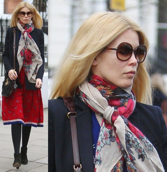 Claudia Schiffer wearing a scarf after dropping her children at school London on January 31 , 2011