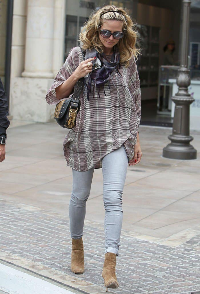 Heidi Klum wearing a skull decorated scarf