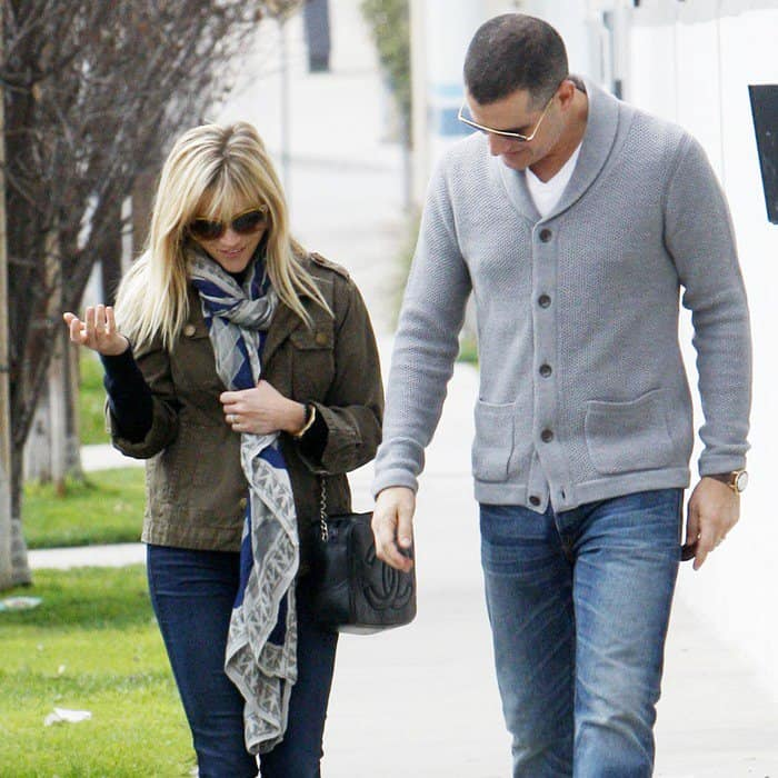 Reese Witherspoon wearing a blue aztec printed scarf from Theodora & Callum
