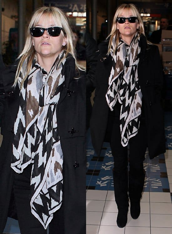Reese Witherspoon wearing a dark scarf with geometric patterns from Theodora & Callum