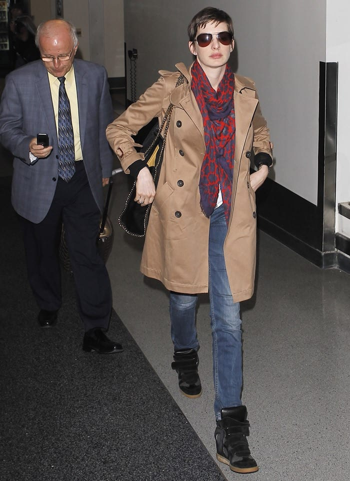 Anne Hathaway wearing Christopher Kane's red leopard print scarf
