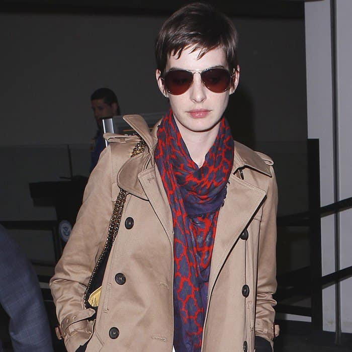 Anne Hathaway wearing a red and blue printed scarf