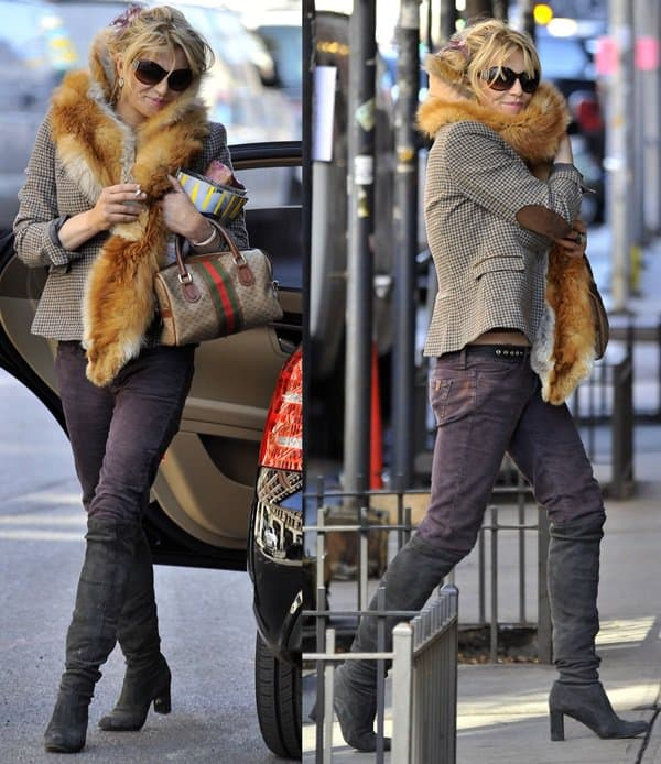 Courtney Love decked herself in a fall appropriate ensemble and capped off the style with a fur scarf for added drama