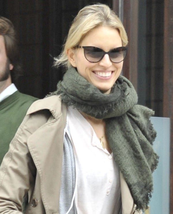 Karolina Kurkova tops her workout wear with a trench coat and a scarf to beat the fall weather and keep herself warm
