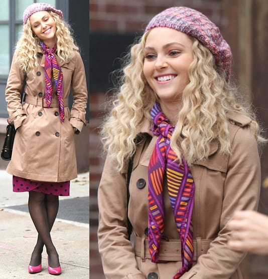 AnnaSophia Robb wore a classic trench coat over a pink polka dotted skirt