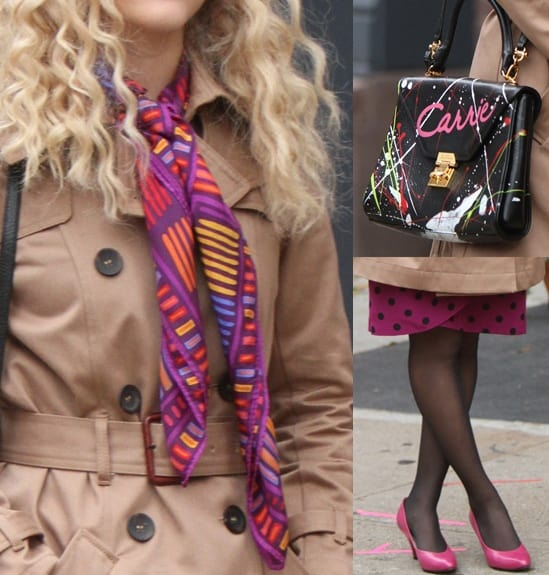 AnnaSophia Robb accessorized with a paint splattered purse in black, pink pumps, a multi-toned beanie, and a gorgeous printed pink silk scarf