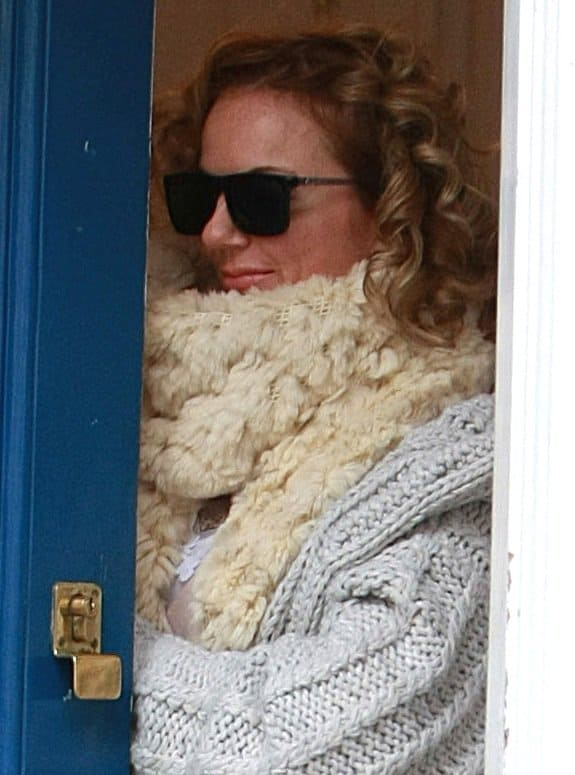 Geri Halliwell keeping warm in a fuzzy and furry extra