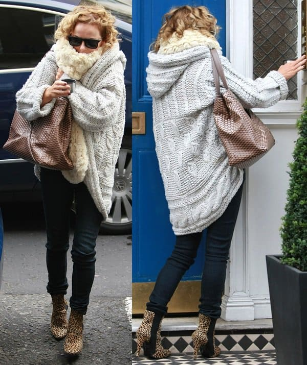 Geri Halliwell heads to a clinic in London in animal print booties, a cable knit sweater, and a furry scarf on December 18, 2012