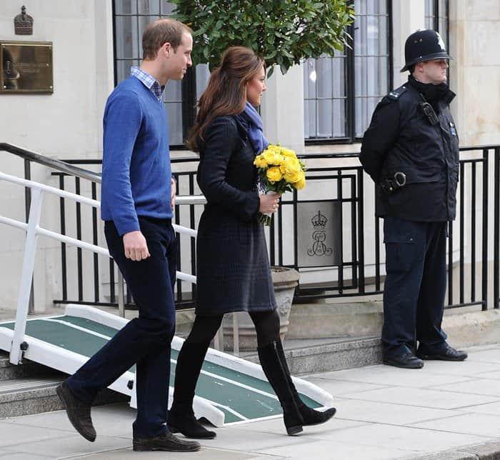 Prince William, Duke of Cambridge and Catherine, Duchess of Cambridge, leave the King Edward VII Hospital together