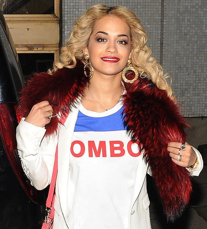 Rita Ora's deep red neck warmer looked plush and luxe