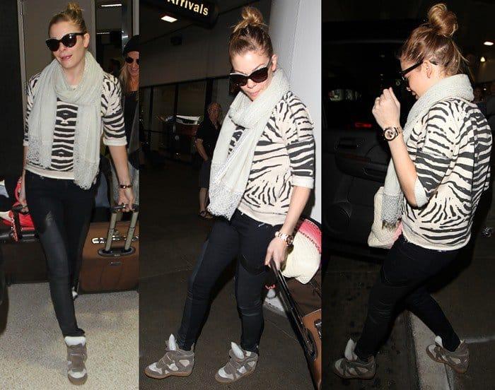 LeAnn Rimes wearing trendy sneaker wedges with her black paneled skinnies and zebra printed sweater