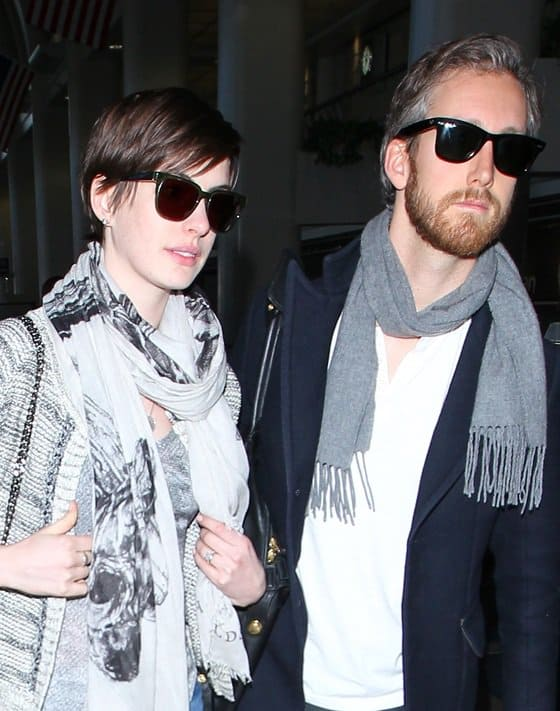 Anne Hathaway and husband Adam Shulman arrive at LAX Airport March 13