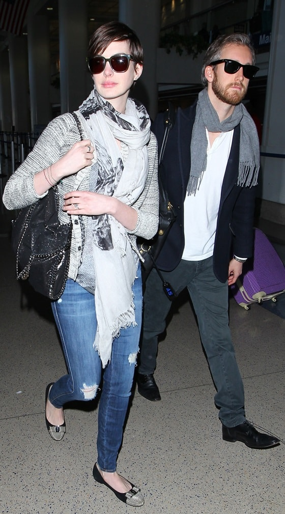March 13 Anne Hathaway and husband Adam Shulman arrive at LAX Airport