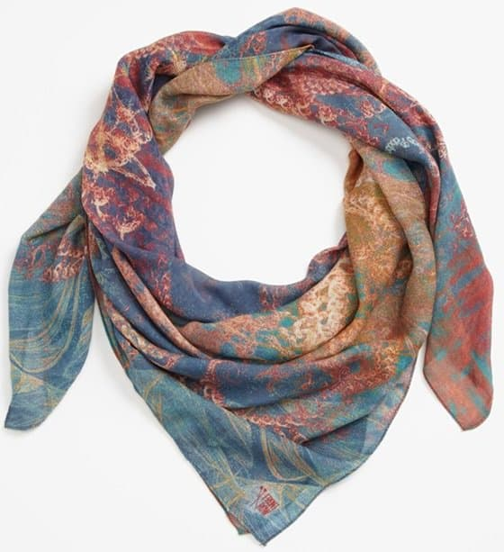 Rich swirls of vermilion and cerulean, indigo and gold crackle and flow across a sheer, sensational scarf designed by a Berlin-based artists' collective