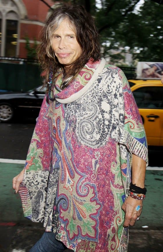 Steven Tyler heads to the Stella McCartney Spring 2014 Presentation in New York while decked in a printed poncho on June 10, 2013