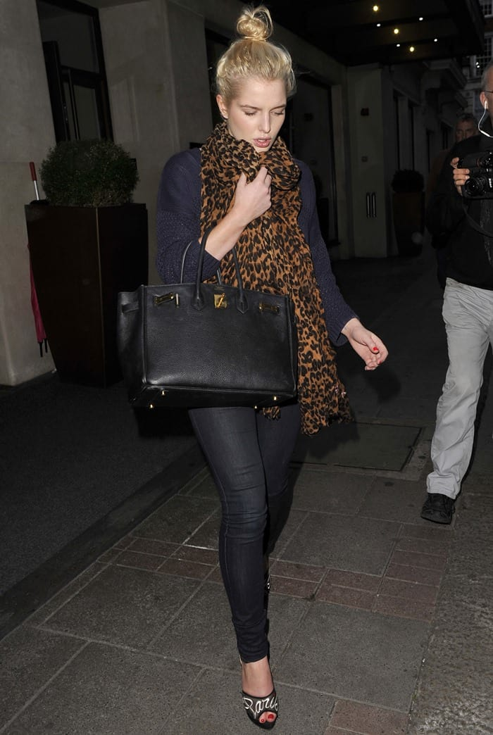 Helen Flanagan spotted leaving her London hotel for a night out with friends, wearing a long leopard print scarf