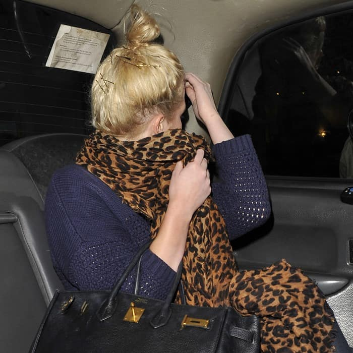 The leopard print scarf was the only cheerful element in Helen Flanagan's outfit