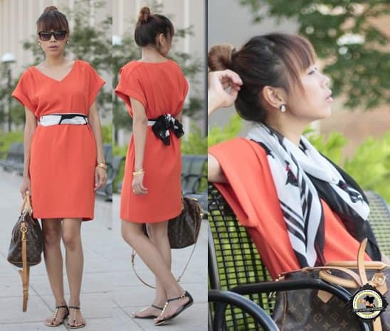 Khin wears her printed scarf as a belt with a gorgeous summer dress