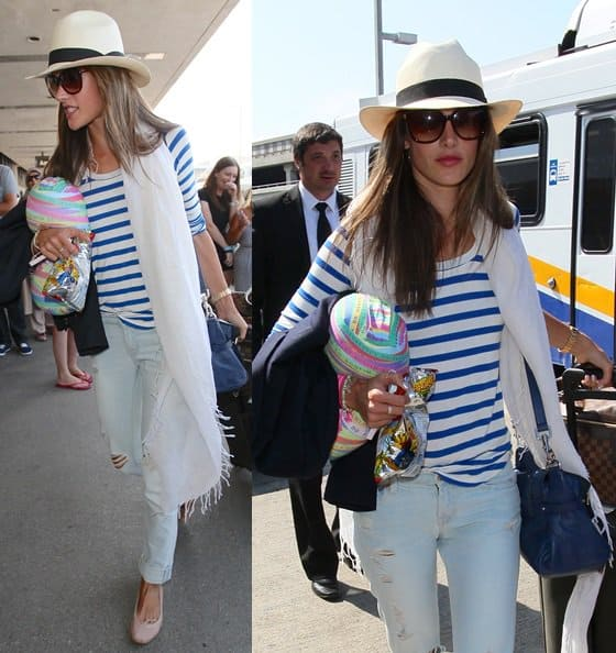 Alessandra Ambrosio wears a nautical striped tee at LAX to catch a flight on August 14, 2013