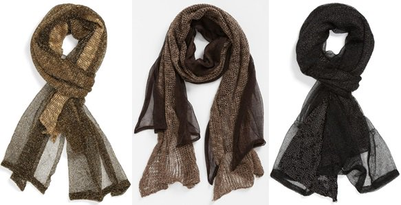 "The ""Thick and Thin"" scarf is crafted from lush knitwork and fashioned with metallic gossamer overlay for added drama"