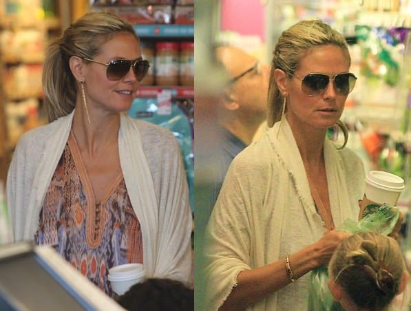 Heidi Klum spends the day with her kids in Brentwood while sporting a printed caftan and a white scarf on August 11, 2013