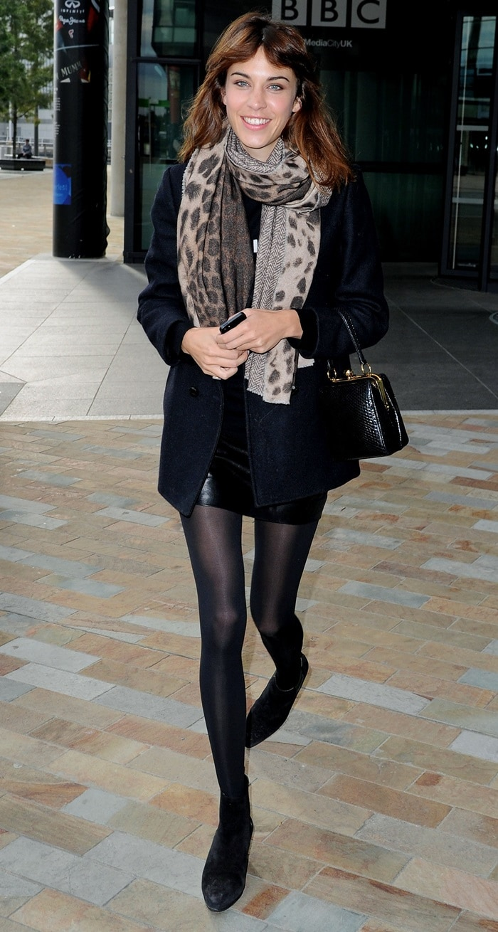 Alexa Chung shows off her double-sided herringbone and leopard print scarf