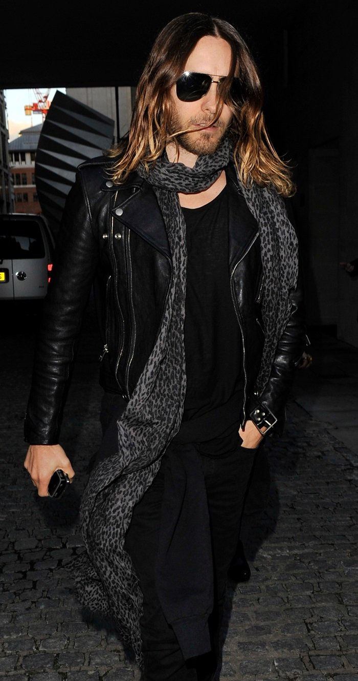 Jared Leto wraps a long leopard print scarf around his neck