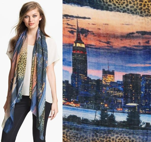 A vibrant and lush scarf features a funky New York skyline edged in unexpected bursts of exotic leopard spots