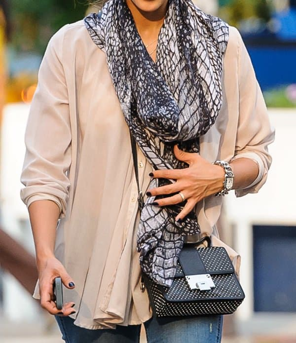 Jessica Alba wears a stunning scarf and a studded Jimmy Choo purse