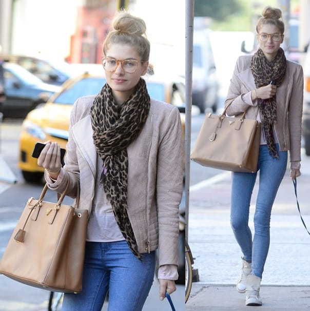 Jessica Hart walks her dog in New York City while decked in a leopard print scarf and nerdy eyeglasses on September 17, 2013