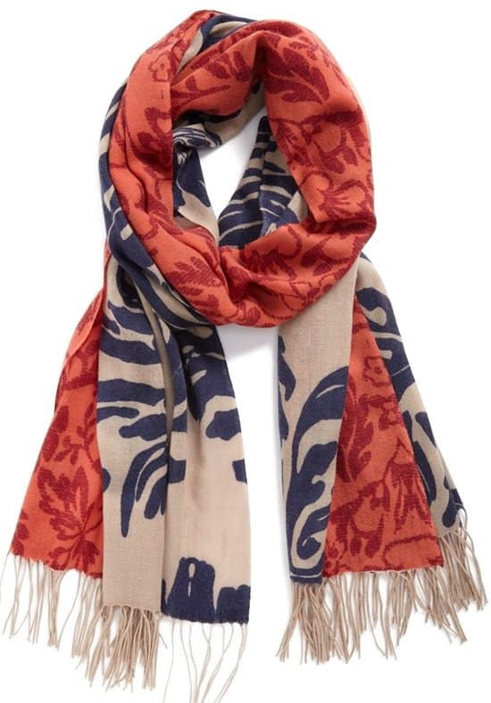 Classic prints pattern a two-tone scarf cast in a soft and cozy blend of wool and cashmere