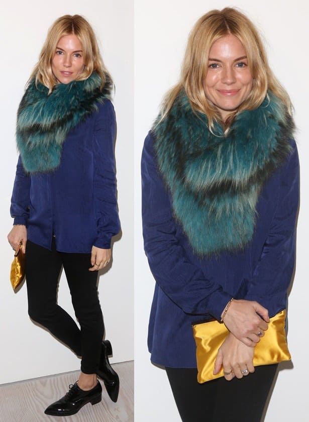 Sienna Miller wears a furry teal green scarf from Charlotte Simone with a blue blouse and skinny pants