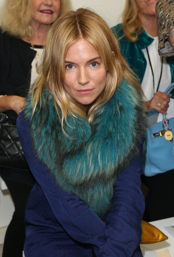 Sienna Miller attends the Matthew Williamson Spring 2014 presentation during London Fashion Week on September 15, 2013