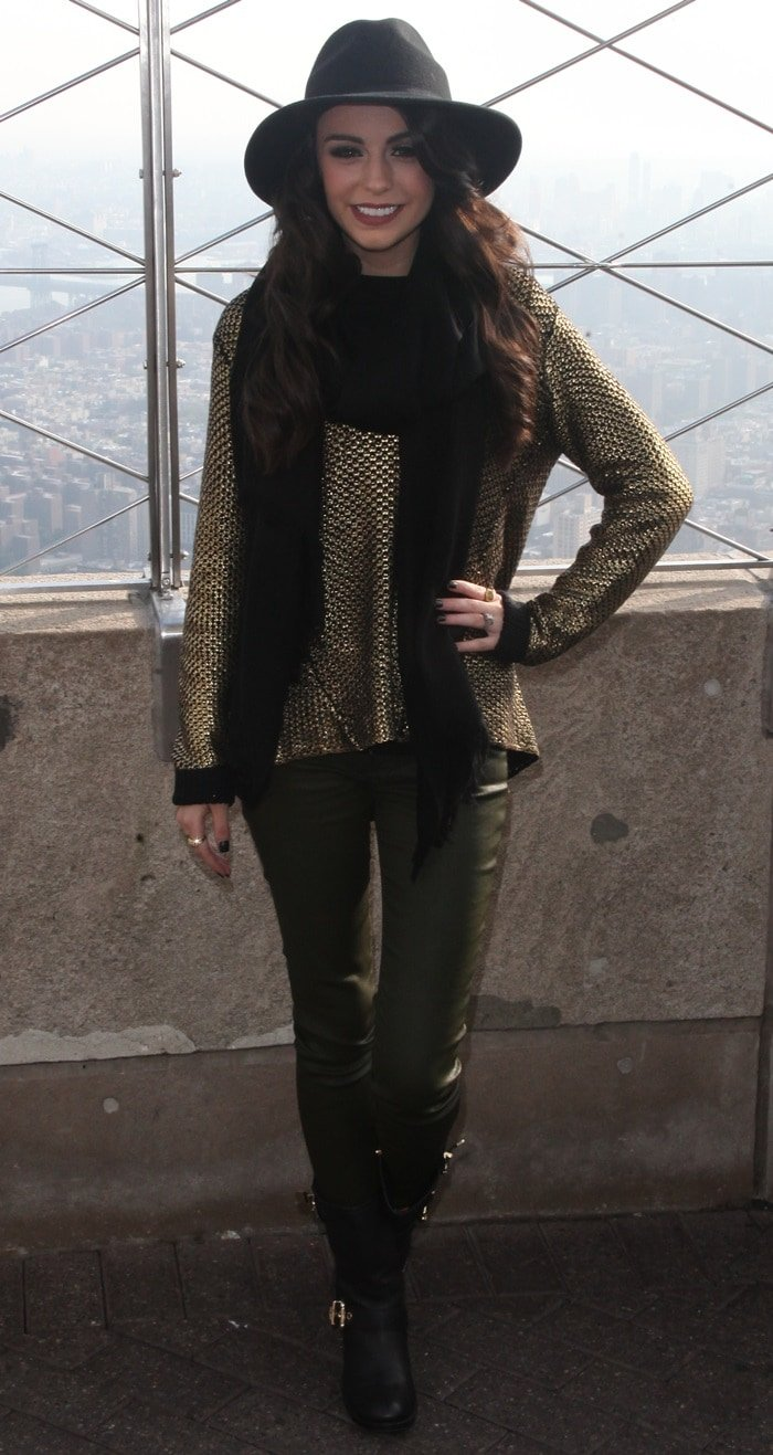 Cher Lloyd paired ametallic bronze sweater with dark green leather pants