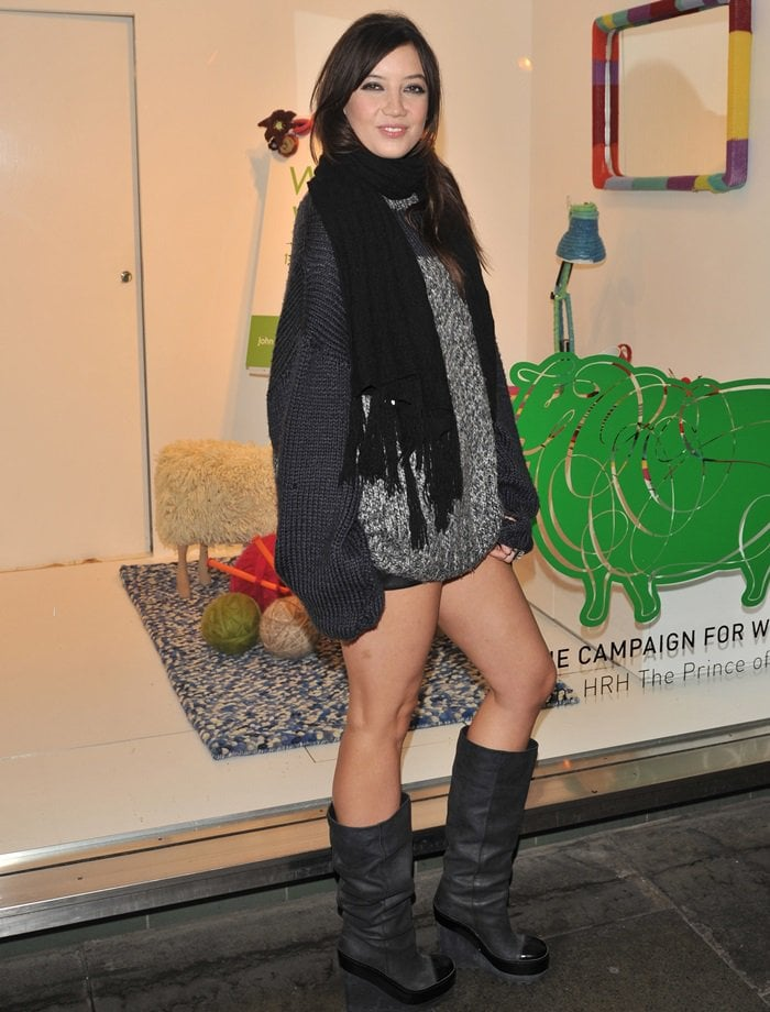Daisy Lowe flaunts her thighs in a wool jumper paired with super short leather shorts and wedge boots