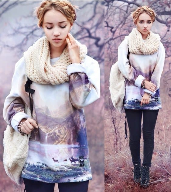 Aksinya wears a super chunky beige scarf with a slouchy sweater
