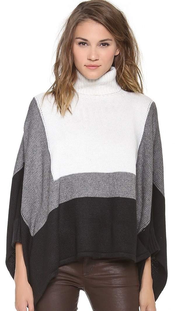 An oversized cut and fitted dolman sleeves bring unique proportions to this colorblock turtleneck sweater