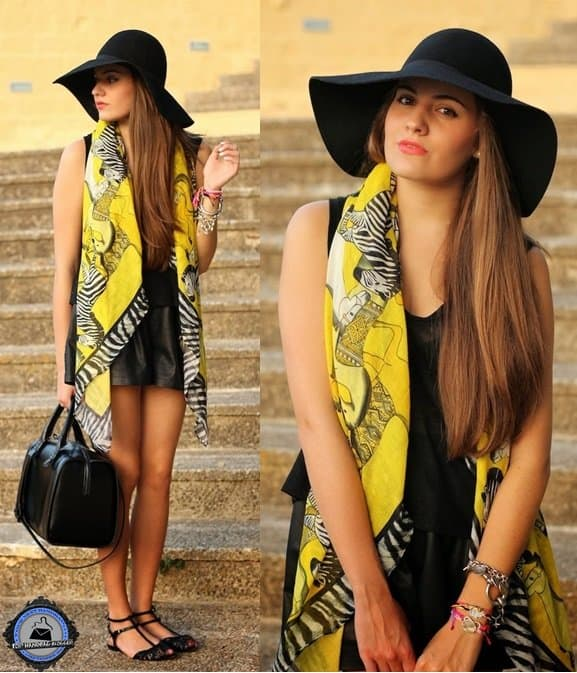 Angie uses a bright yellow zebra-print scarf as the centerpiece of her all-black outfit