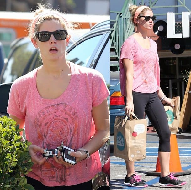 Ashley Greene runs errands in West Hollywood while wearing a pink tee and a pink head wrap with her workout leggings on September 30, 2013