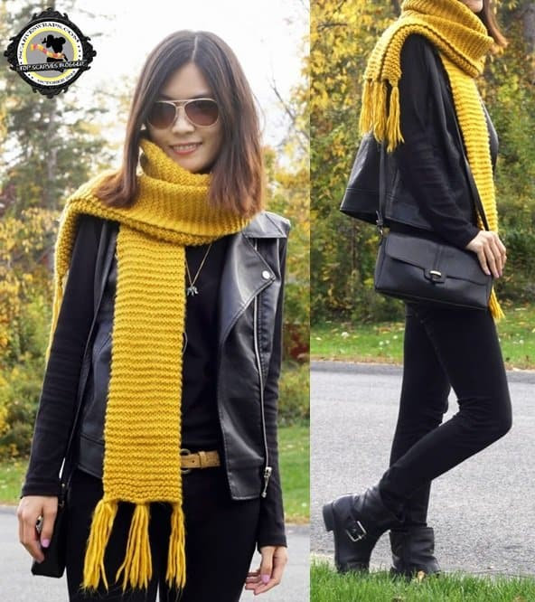 Flora styled her black outfit with a yellow chunky scarf