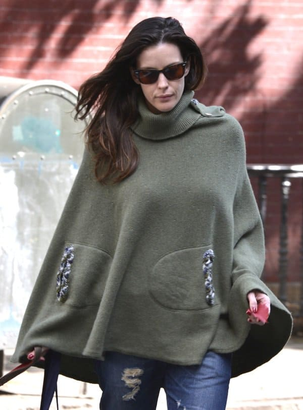 Liv Tyler rocked sunnies and an oh-so-cozy poncho