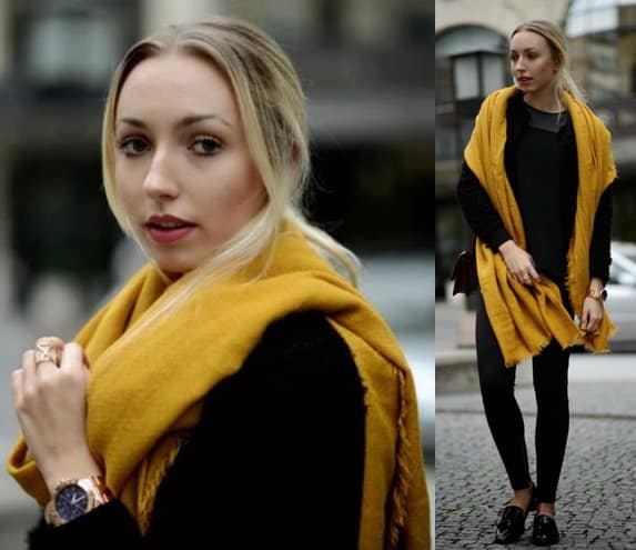 Vanessa keeps an all-black outfit interesting by pairing it with a mustard yellow scarf
