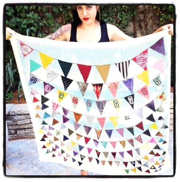 Create a triangle by folding the square scarf diagonally