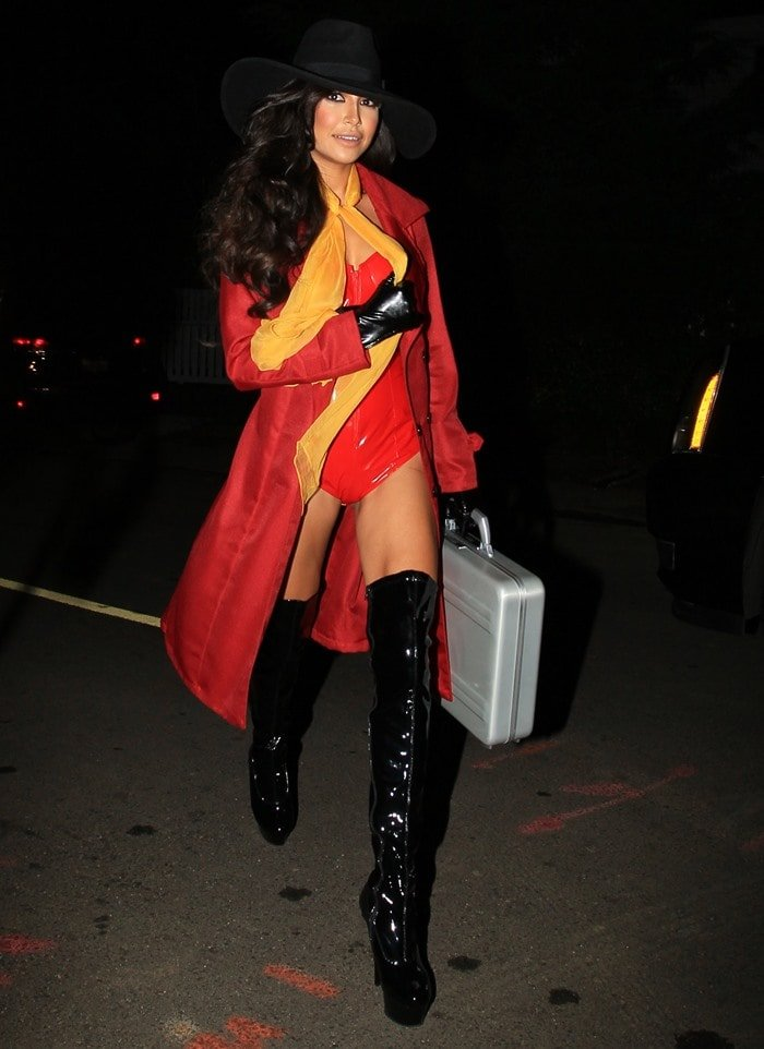 Naya Rivera dresses up as Carmen Sandiego for Kate Hudson's fancy pre-Halloween party on October 27, 2013