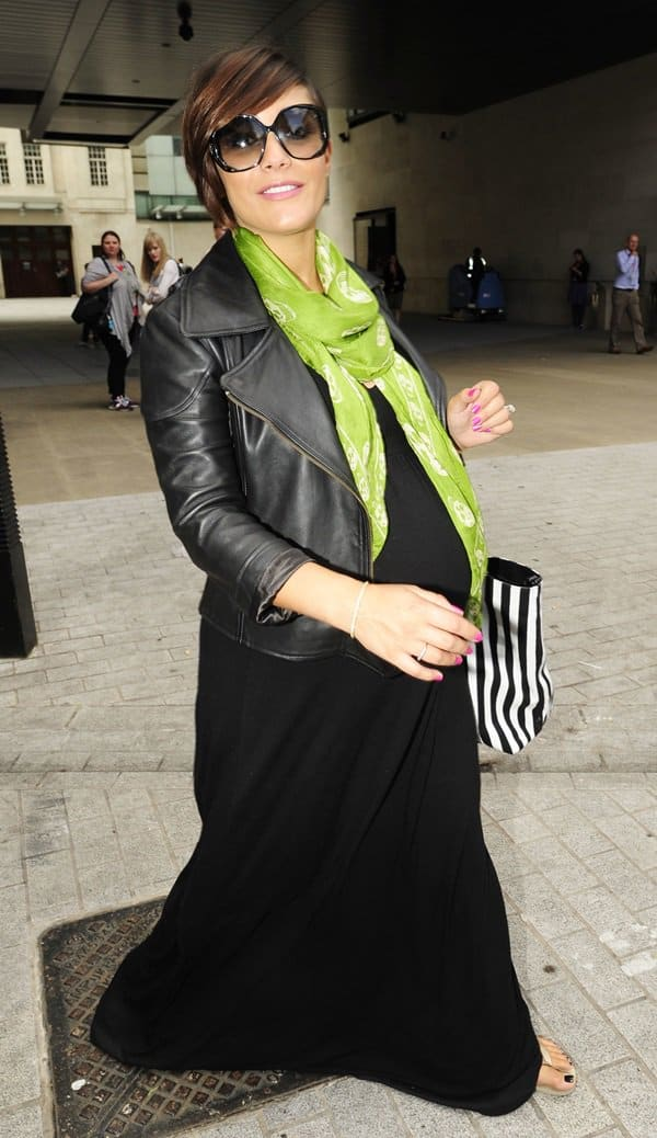 Frankie Sandford of The Saturdays wears a green skull-print scarf with her maxi dress while leaving BBC Radio 1 Studios in London on August 19, 2013