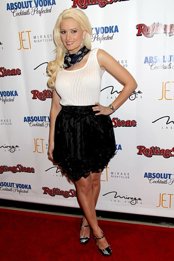Holly Madison accessorizes with a skull scarf around her neck as she attends the Rolling Stone Hot Party at Jet Nightclub in Las Vegas on October 1, 2010